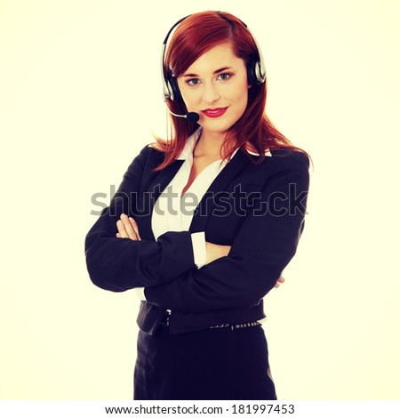 Call center woman with headset. Young businesswoman with headset - stock photo