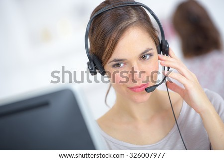 Call centre worker - stock photo