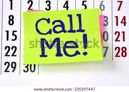 Call Me with an exclamation mark written by hand on sticky paper note and stuck to a wall calendar background. - stock photo