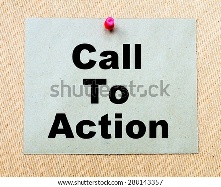 Call To Action written on paper note pinned with red thumbtack on wooden board. Business conceptual Image - stock photo