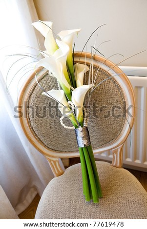 Calla lilies on a chair - stock photo