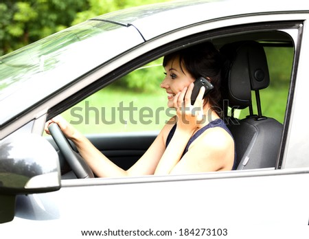calling young woman in the car, travelling - stock photo