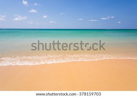 Calm and clear seawater on Karon beach with a blue sky on Karon beach in Phuket Thailand - stock photo