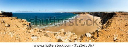 Calm and clear tropical seaside with little rocky hills, Portugal - stock photo