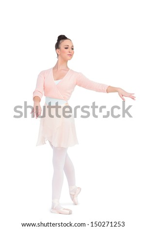 Calm attractive ballerina posing on white background with her arms extended - stock photo