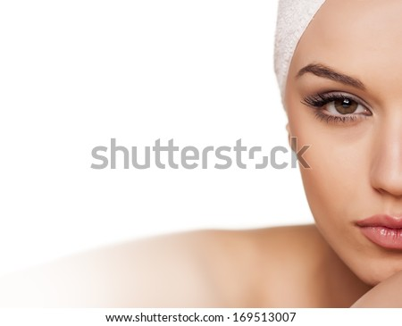 calm beautiful girl with a towel on her head posing on white background - stock photo
