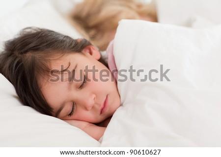 Calm children sleeping in a bedroom - stock photo