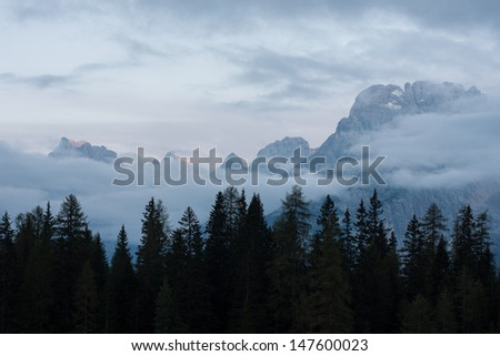 Calm Dolomites peaks after sunset - stock photo