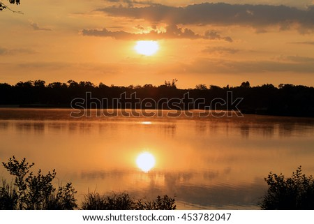 calm lake at sunset - stock photo