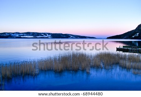 Calm lake scenery from Lapland in the north of Sweden - stock photo