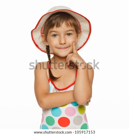 Calm little girl standing in swimming wear and panama hat, isolated over white background - stock photo