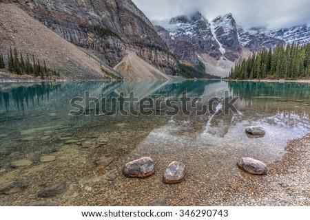 Calm morning at Moraine lake in Banff National Park, Alberta, Canada - stock photo
