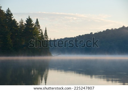 Calm morning in the park show the tree covered mountain in the distance - stock photo