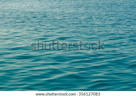 Calm sea surface. Seascape in early morning hours under clear sk - stock photo