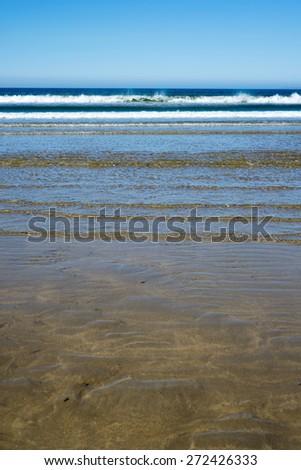 calm soft waves lashing onto ballybunion beach in county kerry ireland - stock photo