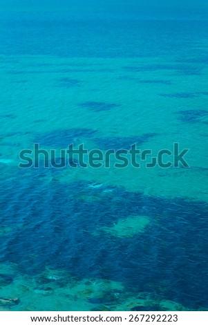 Calm summer aqua sea ocean filling the frame vertical portrait view - stock photo