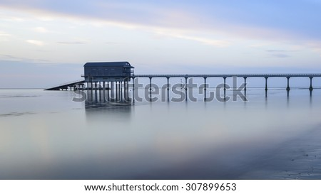 Calm water with a lifeboat station on the Isle of Wight coast - stock photo