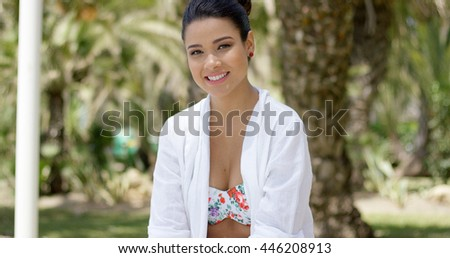 Calm woman sitting by herself on granite bench - stock photo