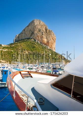 Calpe Alicante marina boats with Penon de Ifach mountain in Mediterranean sea of Spain - stock photo