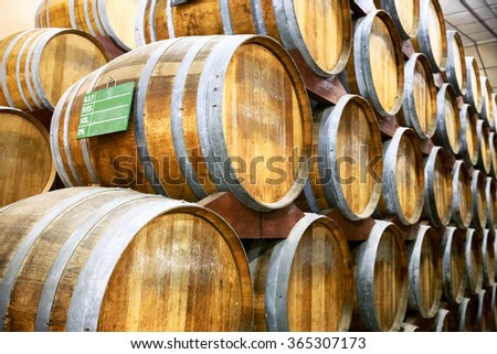 Calvados barrels in storage at the plant in Normandy, France - stock photo