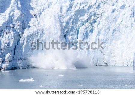 Calving of Marguerite Glacier in Alaska - stock photo