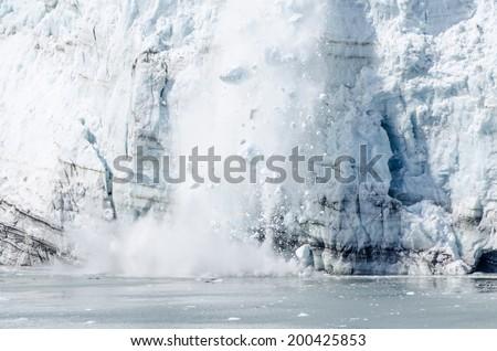 Calving of Marguerite Glacier in Glacier Bay National Park in Alaska  - stock photo