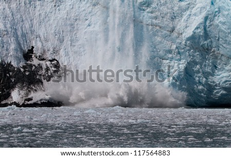 calving tidewater glacier - stock photo