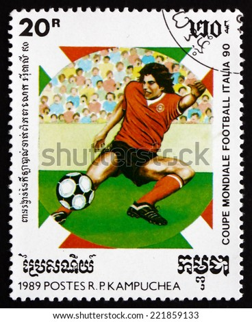 CAMBODIA - CIRCA 1990: a stamp printed in Cambodia shows Soccer Player in Action, 1990 World Cup Soccer Championships, Italy, circa 1990 - stock photo