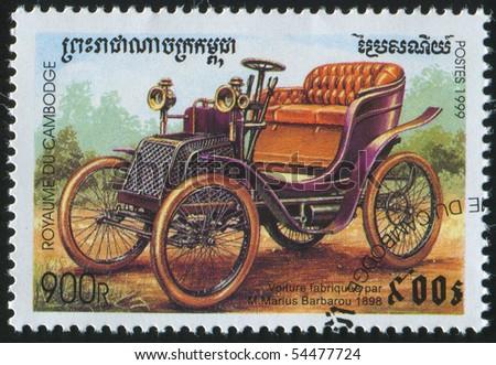 CAMBODIA - CIRCA 1999: stamp printed by Cambodia, shows retro car, circa 1999. - stock photo