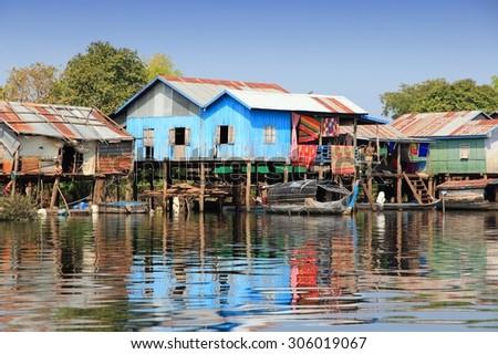 Cambodia - floating village on Tonle Sap lake. Exotic Southeast Asia. - stock photo