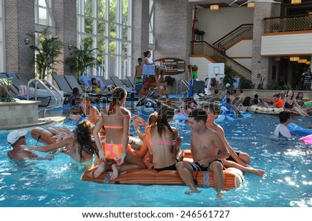 CAMBRIDGE, MARYLAND - AUG 31: Poolside fun at the Hyatt Regency Chesapeake Bay resort in Cambridge, Maryland, as seen on Aug 31, 2014. The resort includes a golf course, spa, and marina. - stock photo
