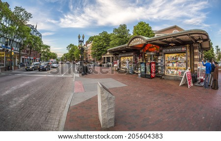 CAMBRIDGE, USA - JUNE 2: Panoramic view of Harvard Square in Cambridge, MA, USA showcasing its historic buildings and the famous Harvard University on the left side on June 2, 2014. - stock photo
