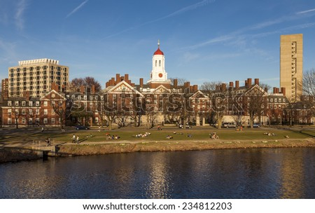 CAMBRIDGE, USA - NOVEMBER 10: View of Cambridge in MA, USA showcasing the architecture of the Harvard University by the Charles River with locals and students  passing by on November 10, 2014. - stock photo