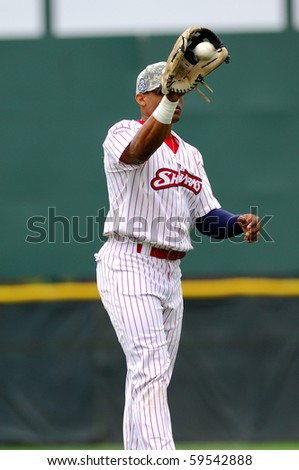 CAMDEN, NJ - AUGUST 15: Camden Riversharks outfielder Richie Robnett catches a ball (ball shown going into glove) during warmups August 15, 2010 in Camden, NJ. - stock photo