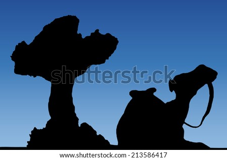 camel silhouette under a tree in an oasis with blue sky  - stock photo