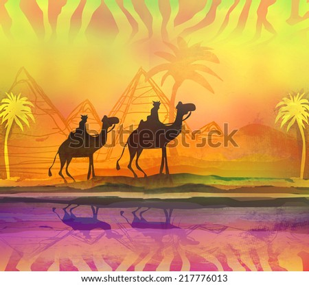 Camel train silhouetted against colorful sky crossing the Sahara Desert  - stock photo