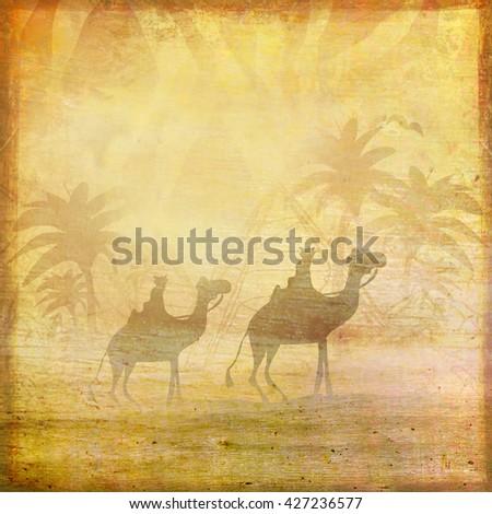 Camel train silhouetted against sky crossing the Sahara Desert - stock photo