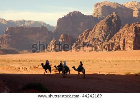 Camel trip in Wadi Rum desert. - stock photo