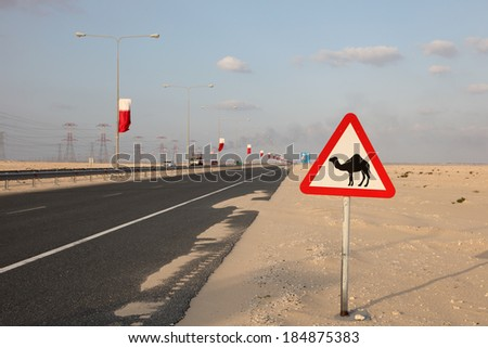 Camel warning sign at the highway in Qatar, Middle East - stock photo