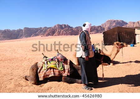 camels and bedouin on desert - stock photo