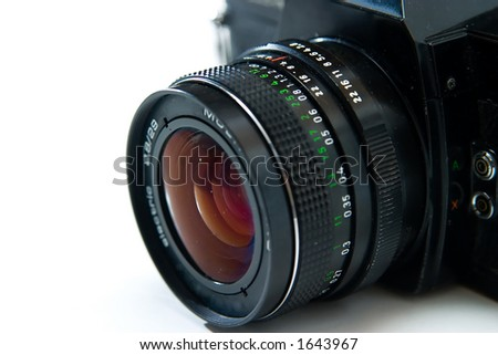 Camera and camera lens on white - stock photo