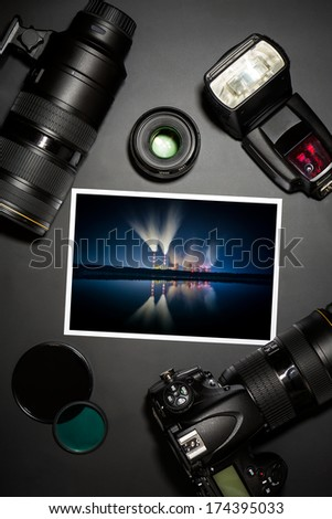 camera and lense on black showing photographer still life  - stock photo