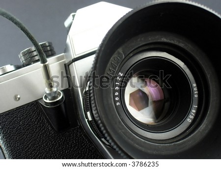 Camera in action. Represent camera aperture in action during the moment of taking picture. - stock photo