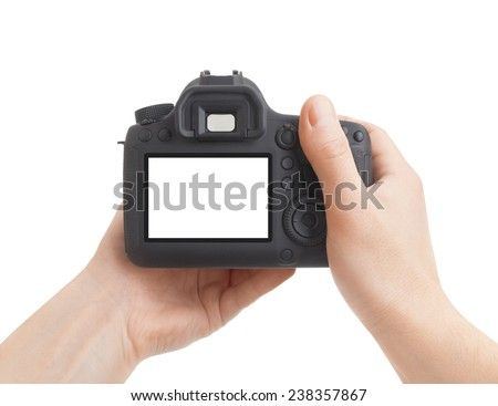 Camera in hand on white background - stock photo