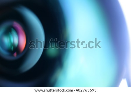 Camera lens closeup. Abstract blue background - stock photo