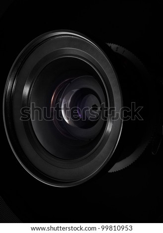 Camera lens on black, clipping path included - stock photo