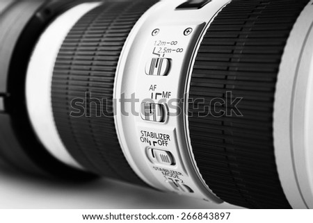 Camera lens on light background - stock photo