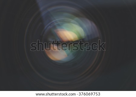 Camera lens with lens reflections. - stock photo