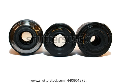 Camera lenses in various sizes on white Background Isolated - stock photo
