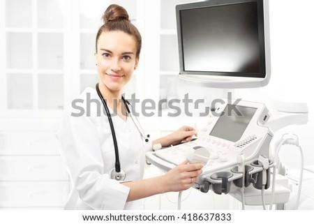 Camera sonogram, the doctor performing the sonogram examination - stock photo